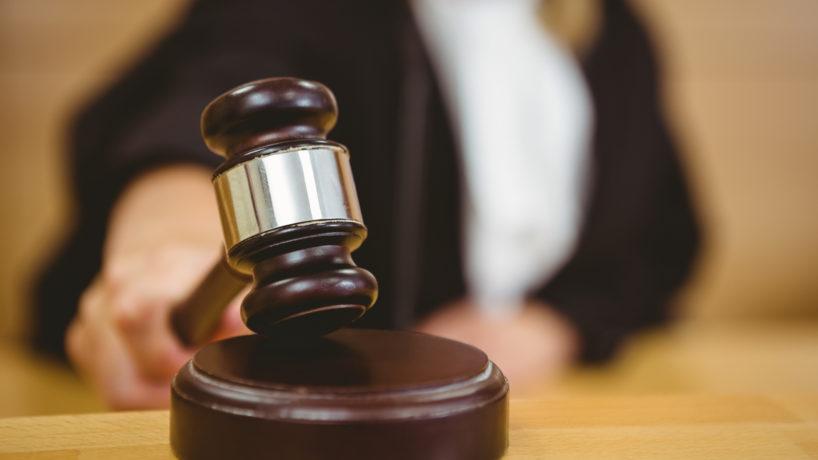 A judge banging a gavel.