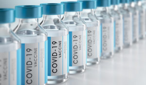 A row of generic COVID-19 vaccine bottles.