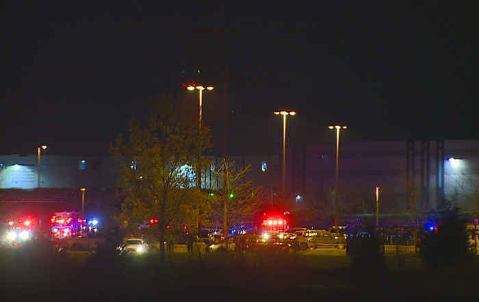 Emergency lights flash at the FedEx facility at the Indianapolis airport