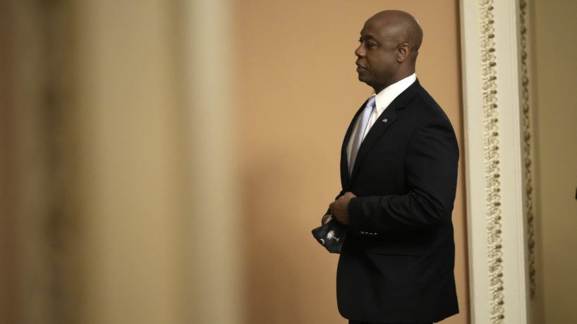 sen tim scott standing alone about to give GOP response
