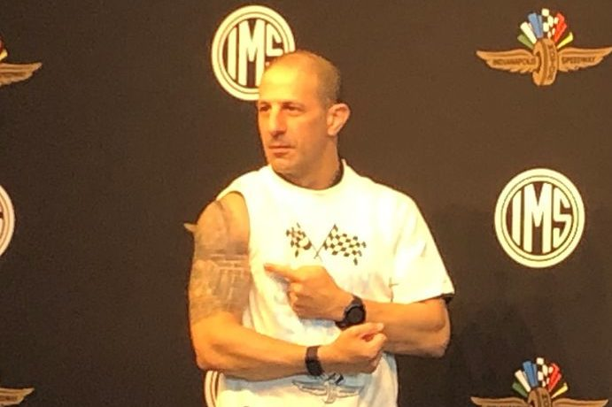 2013 Indy 500 champion Tony Kanaan shows off a yard-of-bricks tattoo where he got his COVID-19 vaccination.