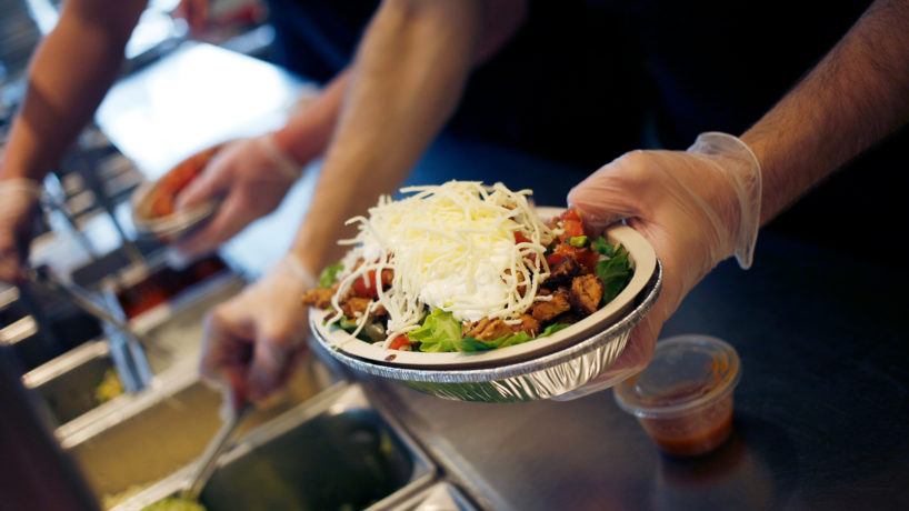 An employee prepares a burrito bowl at a Chipotle Mexican Grill Inc. restaurant in Louisville, Kentucky, U.S., on Saturday, Feb. 2, 2019.