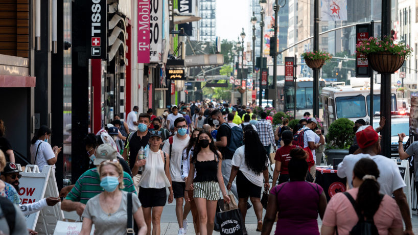 People walk through a shopping area in Manhattan on June 7, 2021 in New York City