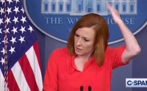 White House Press Secretary Jen Psaki swats at a fly.
