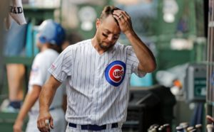 Ben Zobrist #18 of the Chicago Cubs wipes his forehead following his strike out during the fifth inning of a game against the St. Louis Cardinals at Wrigley Field on September 21, 2019 in Chicago, Illinois.