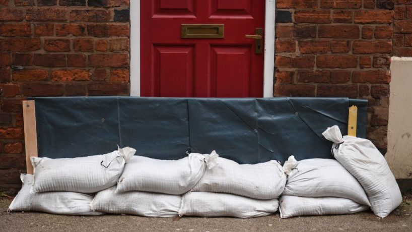 Sandbags are used as a defence against floodwaters in Shrewsbury, northwest England after Storm Christoph brought heavy rains and flooding across the country on January 22, 2021.