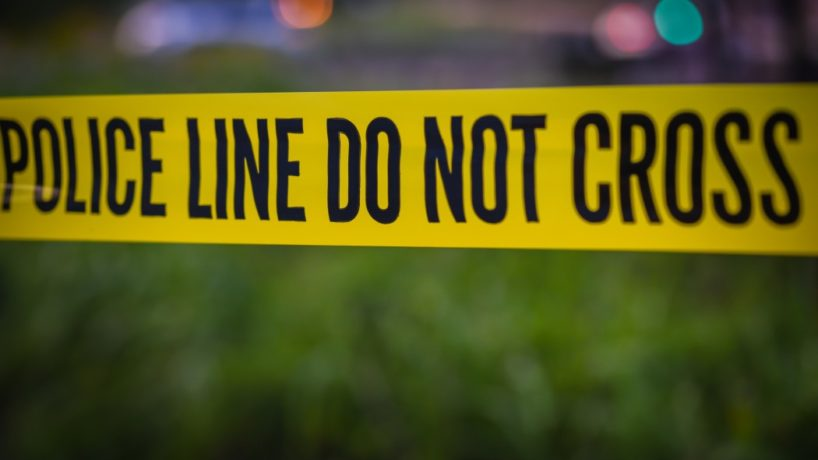 Police barrier tape at crime scene