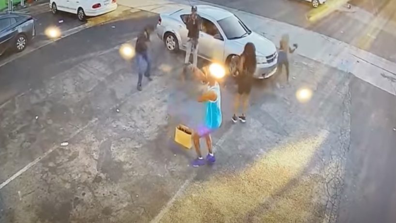 A screenshot from a video shows an attempted robbery in the Fairfax area on Monday. The intended victim shot the two robbery suspects, police said.