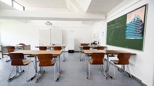 Socially-distanced desks in a classroom