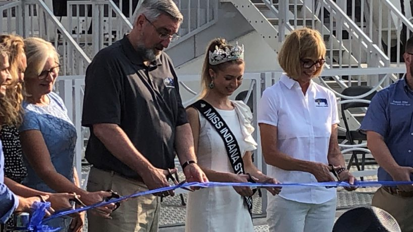(L to R) Indiana Department of Health Commissioner Kristina Box, Gov. Eric Holcomb, State Fair queen Claudia Duncan and Lt. Gov. Suzanne Crouch cut the ribbon to open the 2021 Indiana State Fair