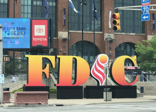 """A sign with big letters """"FDIC"""" outside Lucas Oil Stadium"""