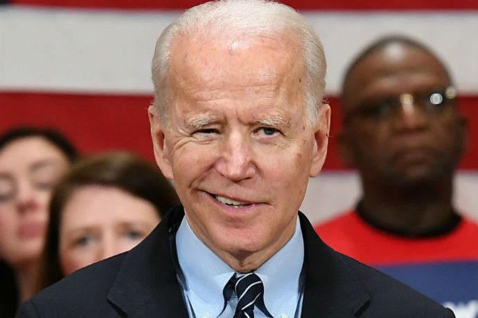 President Joe Biden grins.