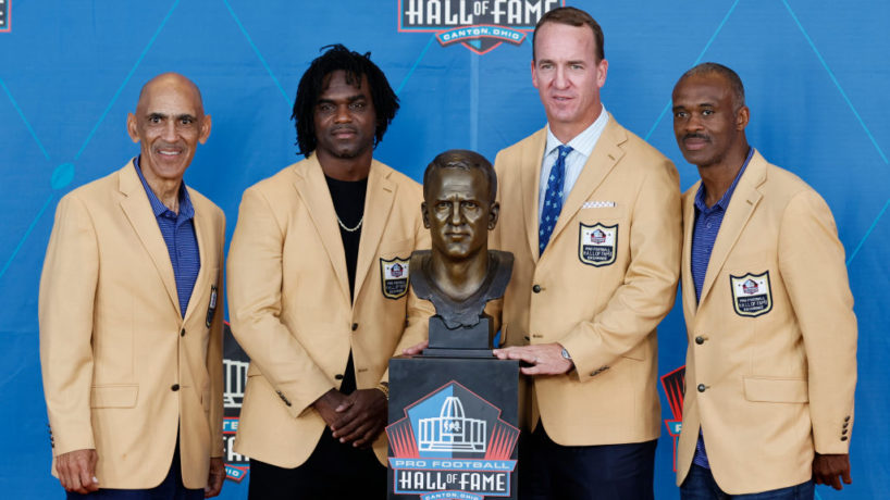 Tony Dungy, Edgerrin James, Peyton Manning and Marvin Harrison pose with Manning's bust during the NFL Hall of Fame induction ceremony of the Pro Football Hall of Fame Class of 202 at Tom Benson Hall Of Fame Stadium on August 8, 2021 in Canton, Ohio.