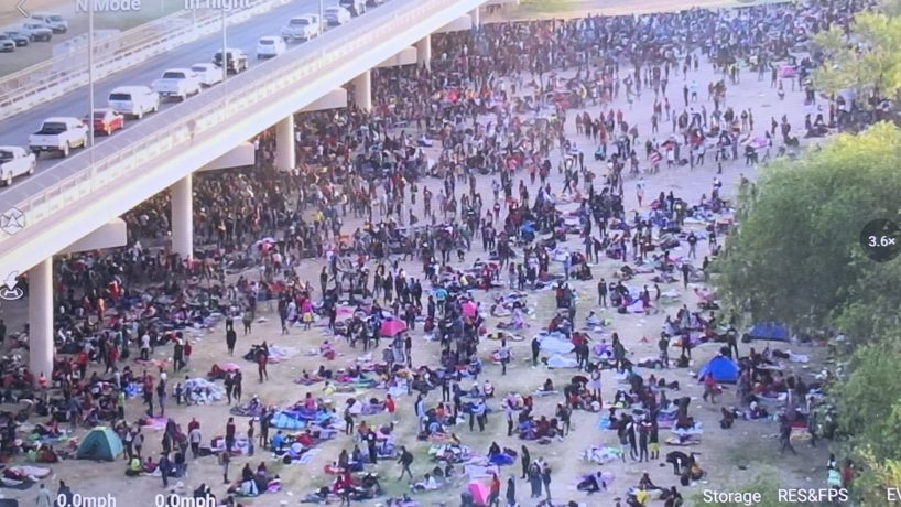 thousands wait at the southern border under international bridge in Del Rio, TX,