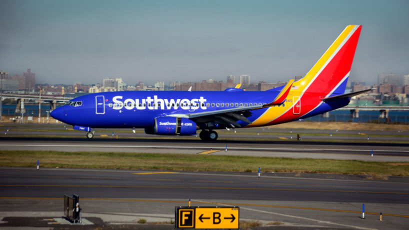 A Southwest Airlines passenger jet (Boeing 737) lands at LaGuardia Airport in New York, New York.