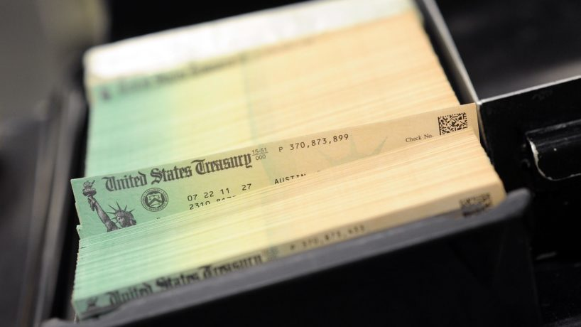 Social security checks are seen piled at the U.S. Treasury in July 2011 in Philadelphia, Pennsylvania.