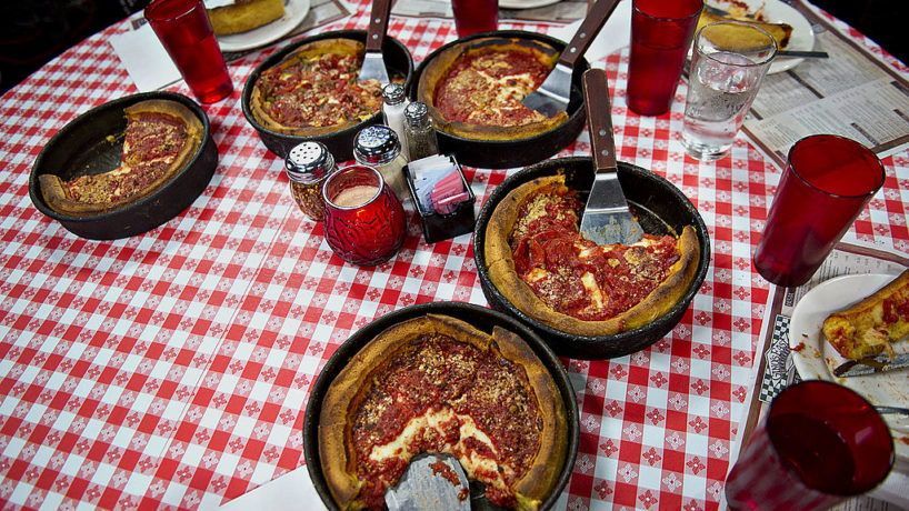 Deep dish pizza sits on a table at Gino's East restaurant in Chicago, Illinois, U.S., on Wednesday, April 18, 2012.