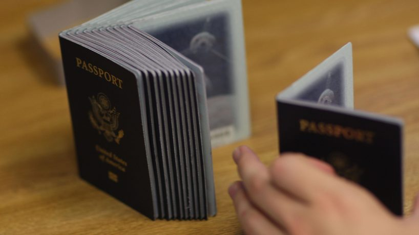 A Passport Processing employee uses a stack of blank passports to print a new one at the Miami Passport Agency June 22, 2007 in Miami, Florida.