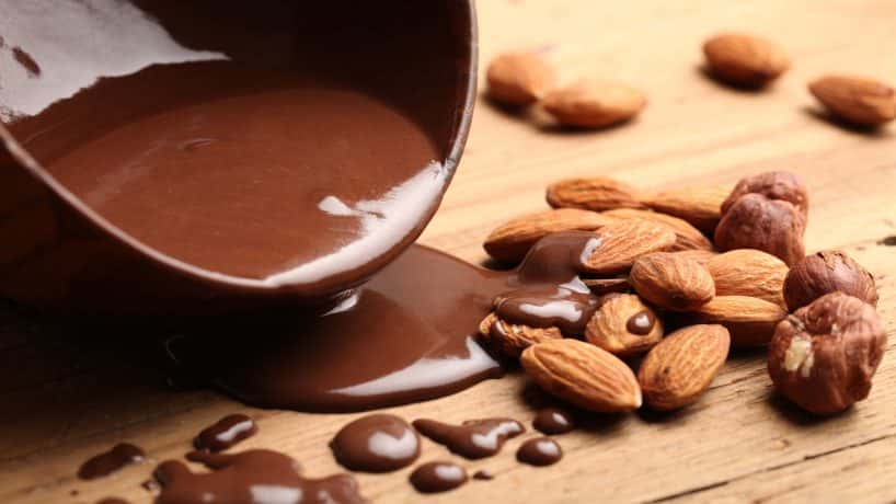 Hot melted chocolate and almond nuts