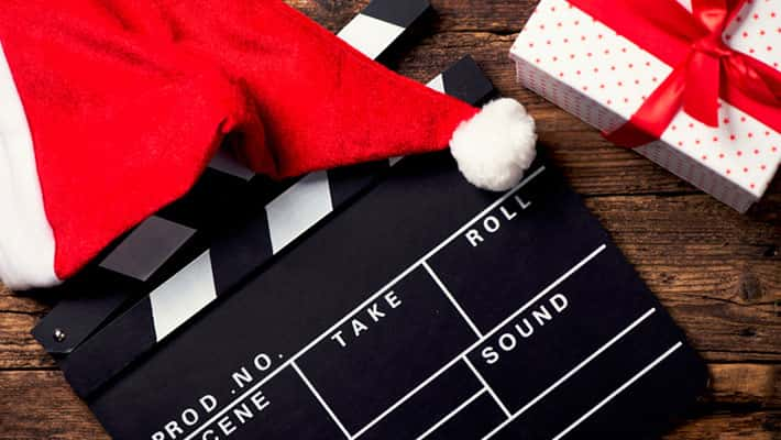 Christmas hat with film board cutout on wood background