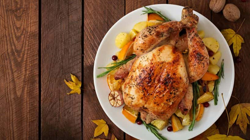 A roast turkey sitting on a platter