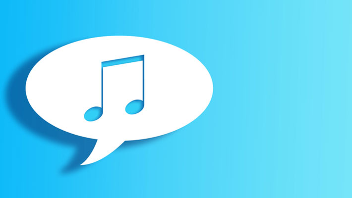 White Chat Bubble With Cut Out music note Shape Over Blue gradient Background with large copy space.