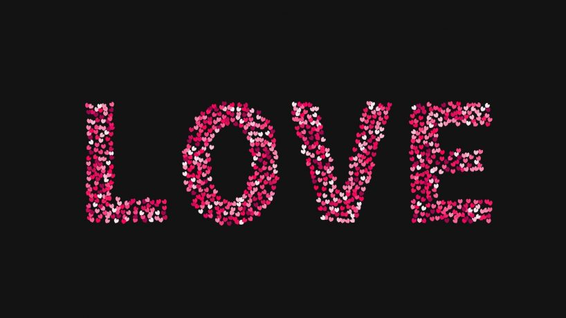 The word love made of little hearts shades of red and pink on black background. Valentine's day typography poster.
