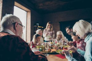 Noel evening family gathering, meeting. Grey-haired grandparents, grandchildren, daughter, son, brother, sister, relatives sitti