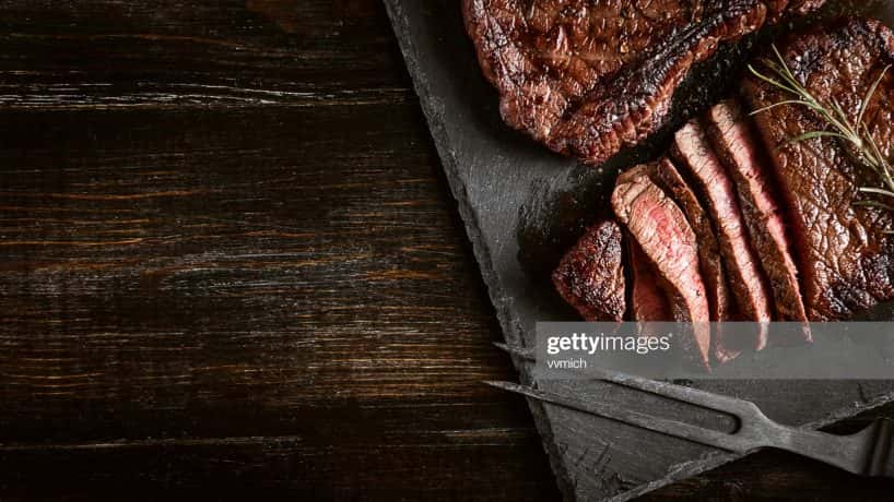 steak on black cutting board