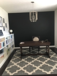 desk in front of wall painted black