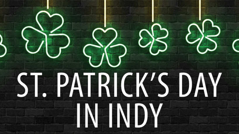 St. Patrick's Day in Indianapolis with neon clovers hanging over the words
