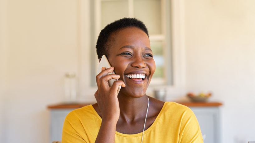 Smiling African American woman talking on the phone