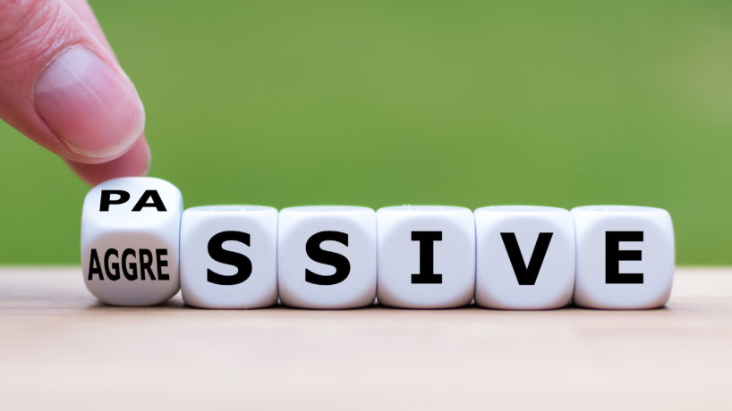 "Hand turns a dice and changes the word ""passive"" to ""aggressive"", or vice versa"