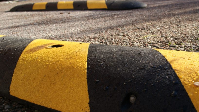 Speedbumps on a sunny morning. Placed on pavement to slow down speed of motorbikes, mopeds, cars and bicycles.