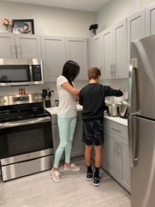 2 people in kitchen