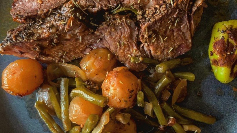 a pot roast plated with green beans