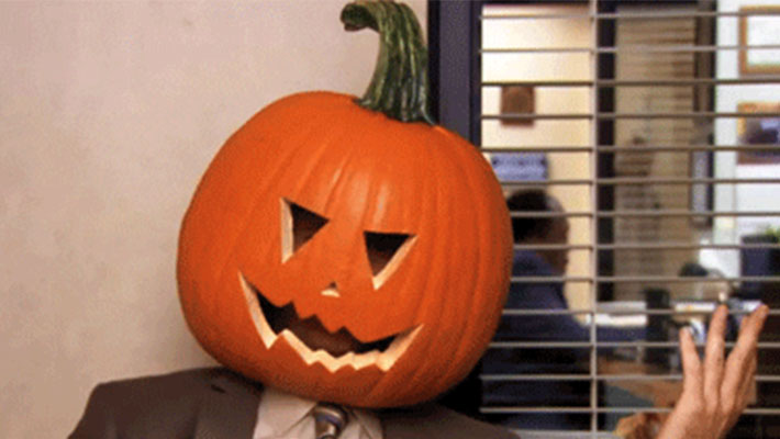 Dwight from The Office with a pumpkin on his head