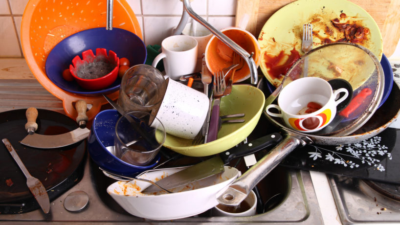 huge heap of dirty disgusting dishes in the sink waiting to be washed by unreliable flatmate