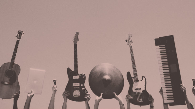pink instruments, guitars, microphone, and piano held in the air