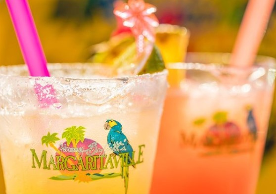 Jimmie Buffett's Margaritaville on a cup filled with a drink and a straw