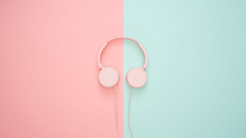 headphones in the middle with pink and blue on the sides