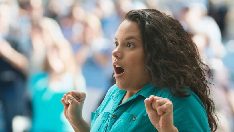 Shocked female spectator - stock photo