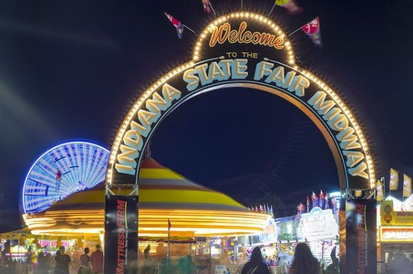 Indiana State Fair arch lit up in the night sky
