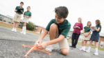 Middle-school science class launching rockets