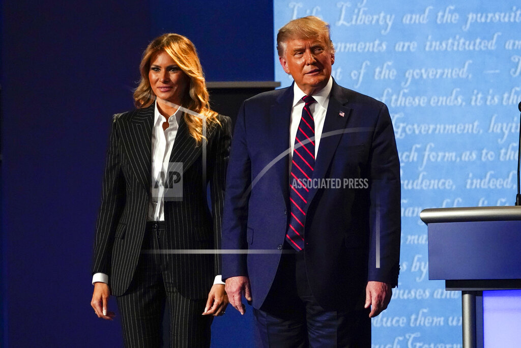 President Donald Trump stands on stage with first lady Melania Trump after the first presidential debate with Democratic presidential candidate former Vice President Joe Biden Tuesday, Sept. 29, 2020, at Case Western University and Cleveland Clinic, in Cleveland, Ohio. (AP Photo/Julio Cortez)