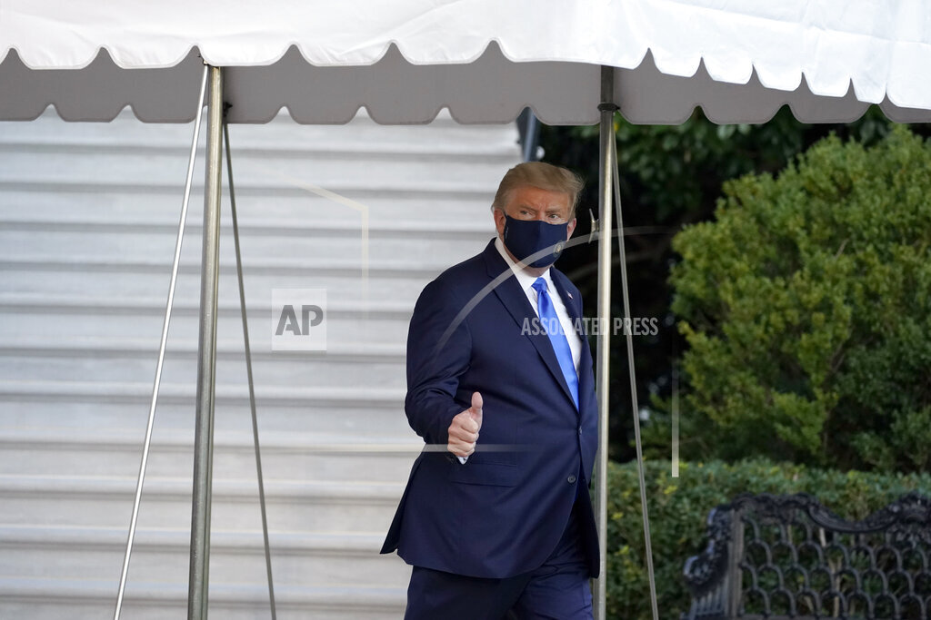 President Donald Trump gives a thumbs-up as he leaves the White House to go to Walter Reed National Military Medical Center after he tested positive for COVID-19, Friday, Oct. 2, 2020, in Washington. (AP Photo/Alex Brandon)