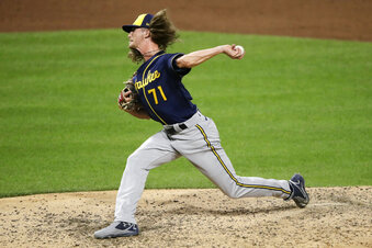 FILE - Milwaukee Brewers' Josh Hader delivers during the ninth inning of a baseball game against the Pittsburgh Pirates in Pittsburgh, in this Wednesday, July 29, 2020, file photo. The Milwaukee Brewers avoided going to arbitration with pitchers Josh Hader and Brandon Woodruff by signing the former All-Stars to one-year contracts. Hader signed for $6.675 million. (AP Photo/Gene J. Puskar, File)