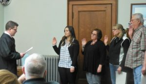 Magistrate David Morain (left) swearing in County Treasurer Katlynn Gannon-Mechaelsen, County Recorder Marcia Tasler, Supervisors Dawn Rudolph and Tom Contner