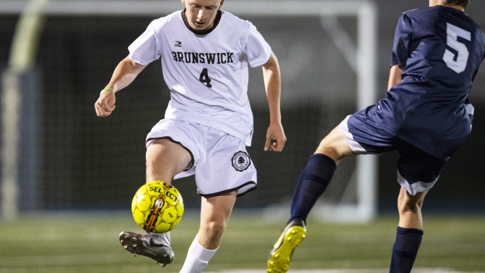 The Brunswick soccer team takes to the field earlier this year against Cheshire Academy. The athletic program will have a new athletic director starting in the fall, as Cedric Jones, a former wide receiver for the Patriots, was hired.