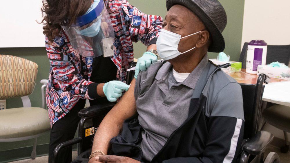 Nurse administering vaccine